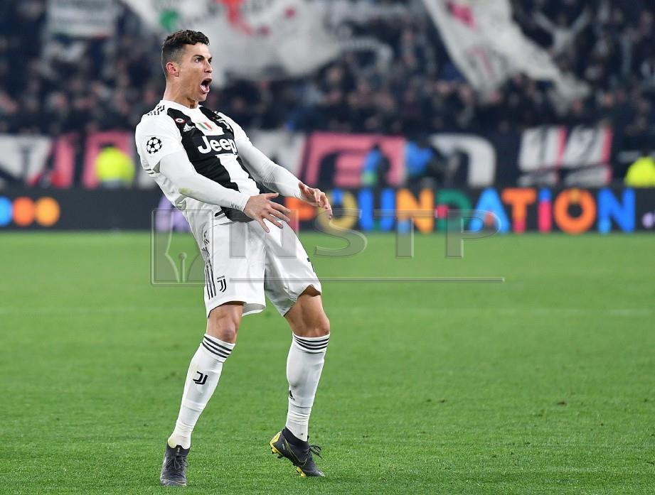 GAYA kurang sopan Ronaldo ketika meraikan gol ketiga menentang Atletico, minggu lalu. — FOTO EPA