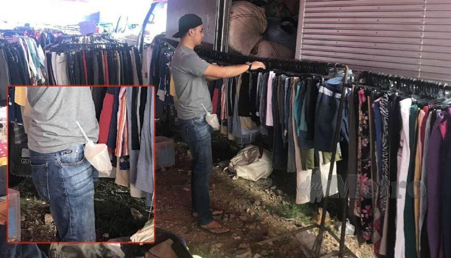 GAMBAR Fadhli yang tular di media sosial selepas dia menggantungkan sampah di gelung tali pinggangnya ketika milih pakaian terpakai di Kundasang, Sabah, Jumaat lalu.