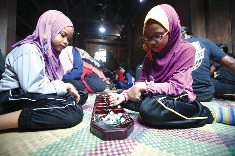 PROSES perbandaran dan perkembangan teknologi memberi impak besar terhadap permainan tradisional. FOTO Mohd Hairul Helmy Mohd Din
