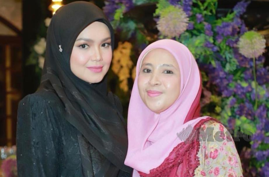 ROZI bersama Siti.