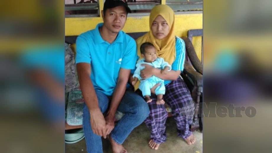 Nor Farhana bersama suami dan Sofea yang memerlukan bantuan. FOTO Ihsan Nor Farhana Abdul Rahim