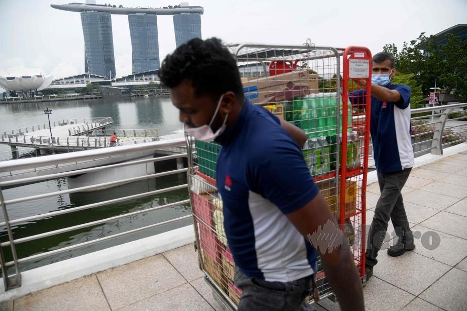 SINGAPURA catat 533 kes baru Covid-19. FOTO AFP