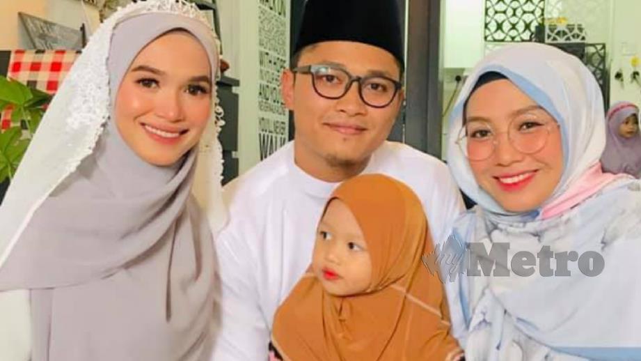 NUR FATHONAH (kiri) bersama isteri pertama, Khuzatul Atiqah (kanan) selepas diijabkabulkan dengan Samuel Dzul, baru-baru ini. FOTO Ihsan Khuzatul Atiqah