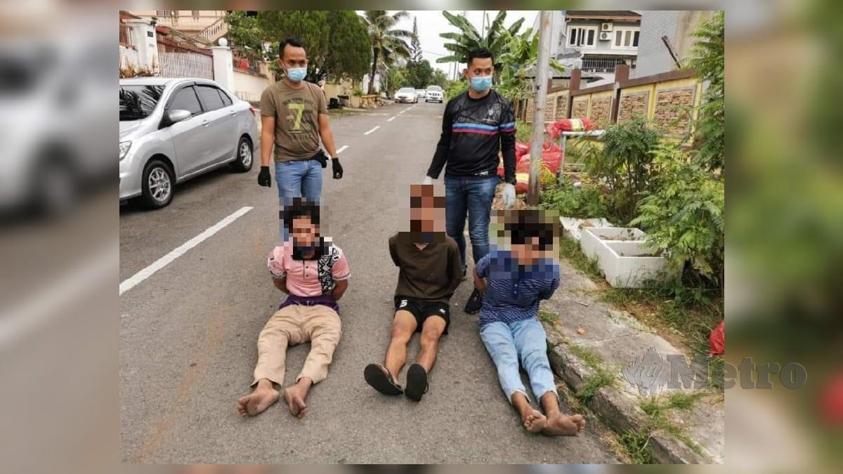 Tiga daripada empat tahanan yang melarikan diri dari pusat kuarantin pesakit Covid-19 ILMAN berjaya ditahan semula di Taman Wijaya, Manggatal, Penampang hari ini. Foto Ihsan PDRM