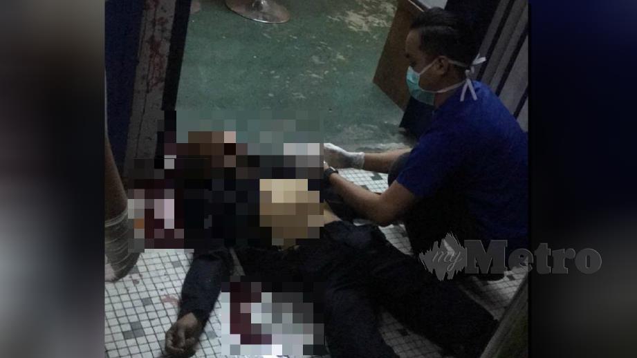 ANGGOTA polis rebah selepas menembak diri sendiri. FOTO ihsan PDRM