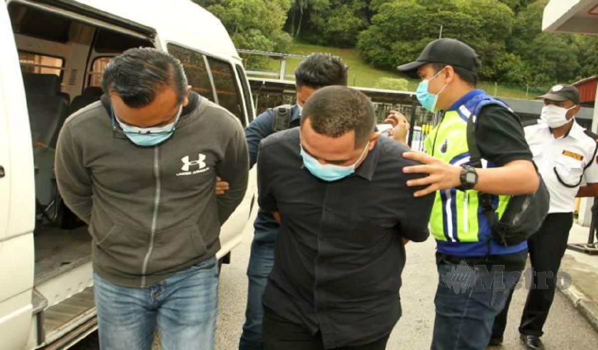 Kedua-dua tertuduh dibawa ke Mahkamah Majistret hari ini. FOTO Farid Noh.