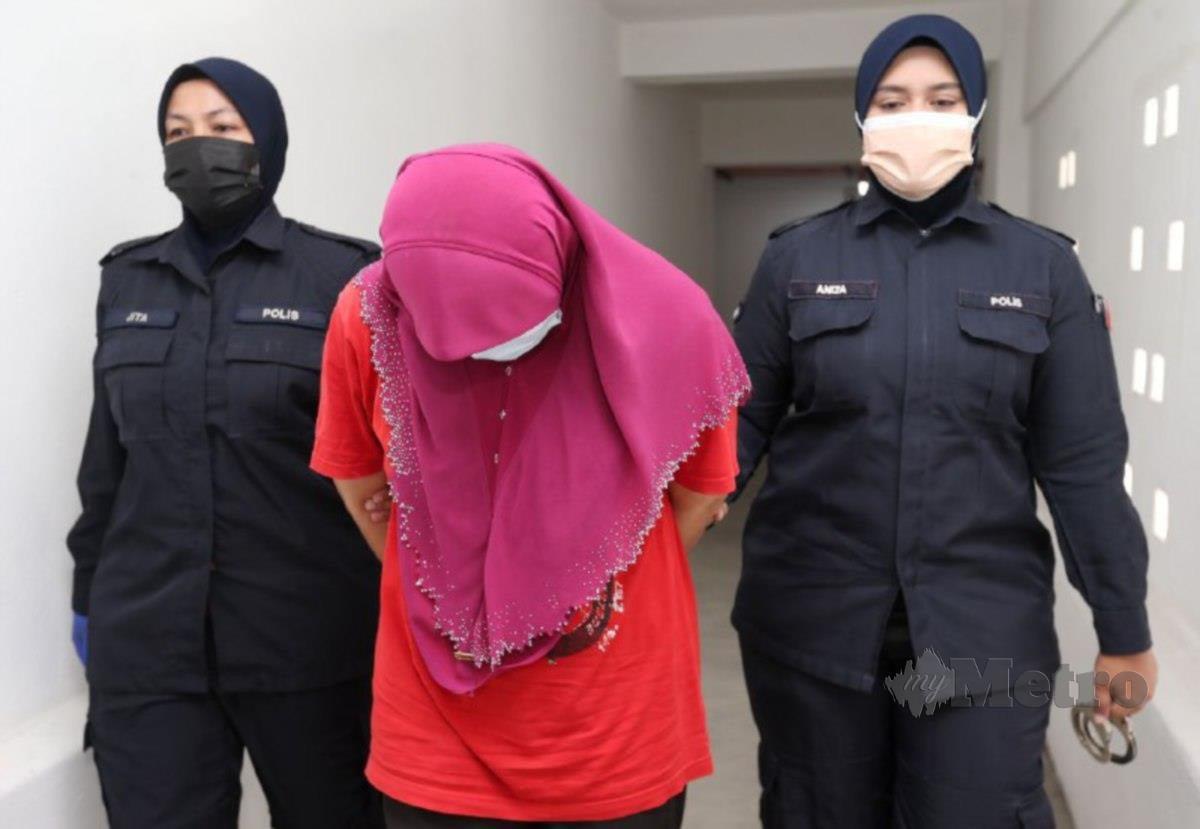 ALIMI Wahidah dihadapkan ke Mahkamah Majistret di sini, hari ini, di atas pertuduhan memeras ugut suaminya. FOTO Nik Abdullah Nik Omar
