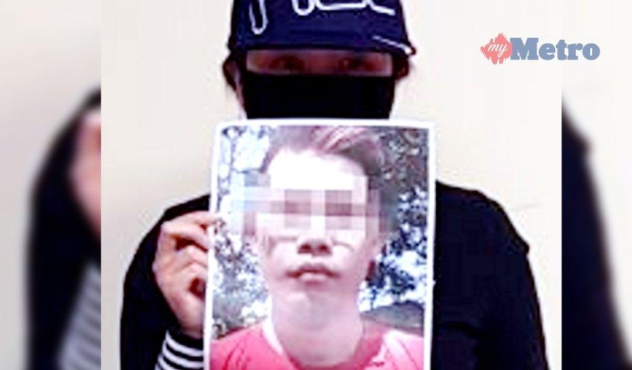 NG menunjukkan gambar suspek. FOTO NSTP