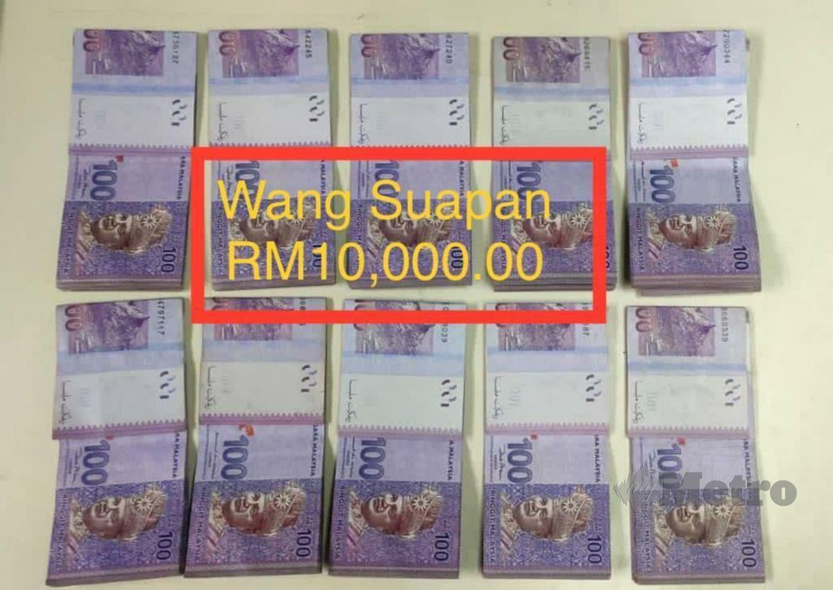 WANG tunai sebanyak RM10,000 yang dirampas daripada suspek. FOTO ihsan PGA