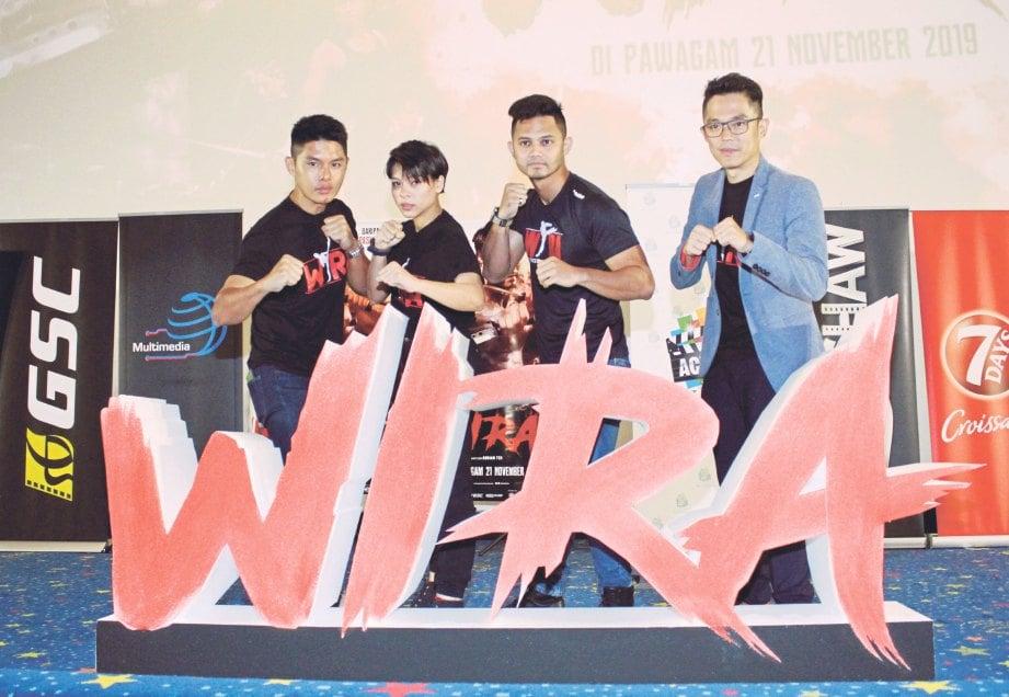 ADRIAN (kanan) bersama barisan pelakon, Hairul (dua dari kanan), Fify Azmi serta Henley Hii selepas sidang media filem Wira, baru-baru ini. FOTO Syakirah Azhar