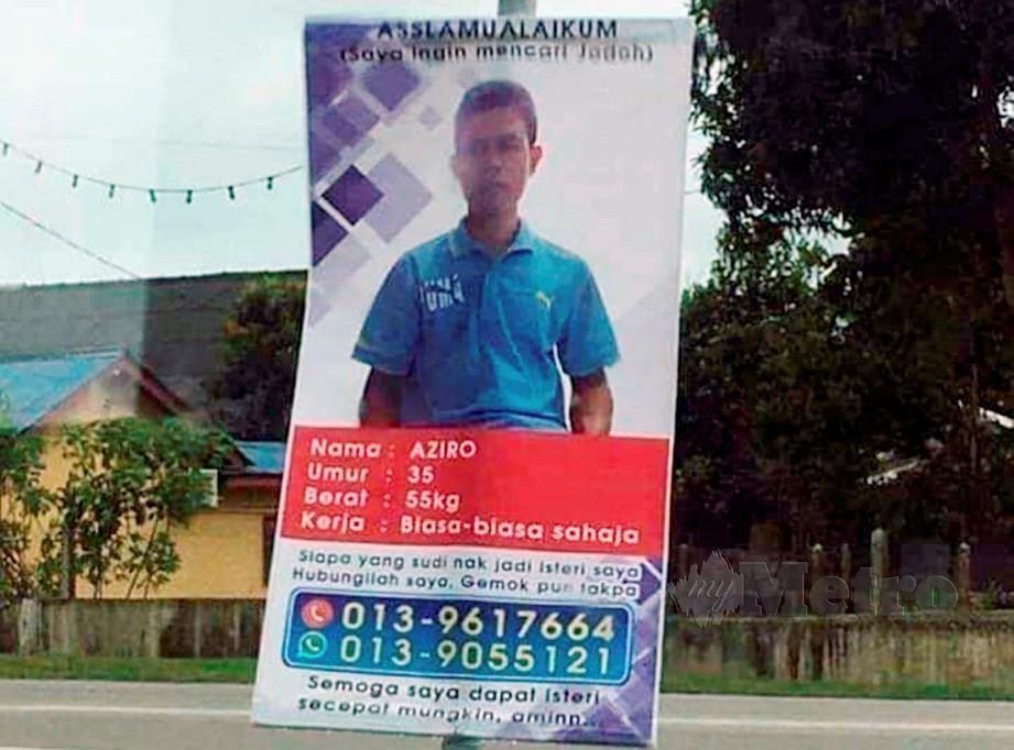 NOORAZIRO menggantung poster di tepi jalan sebagai jalan terakhir untuk mencari jodoh.