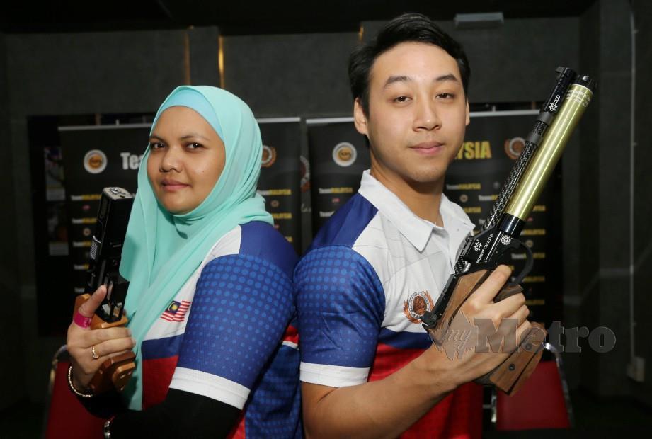 Atlet menembak negara, Nur Suryani dan Johnathan Wong Guanjie (kanan). FOTO File NSTP